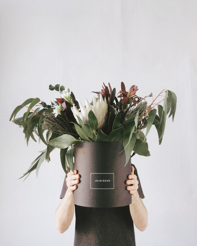 vase of drooping flowers